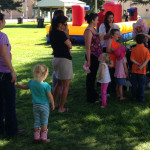 Face painting festival fun Giggle Loopsy Denver area clown